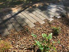 Rustic timber look railway sleeper path - landscaping Brisbane and Sunshine Coast
