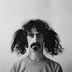 Frank Zappa — Arguably the ultimate mustachioed rock star to ever walk the planet.  –Photo by Jerry Schatzberg, New York City, 1967