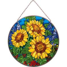 Joan Baker Designs Sunflower Field Glass Art Panel by Joan Baker Designs. Save 10 Off!. $36.99. Display a glorious garden all year long. Hand-painted art glass window panel. 100-percent lead free. Bronzed metal frame with chain. Original art from joan baker designs. Sunshine for Inside. This Art Panel explodes with all the vibrant hues of a summer garden. Deep colors and rich detail make this hand-painted art glass piece a treasured gift or element of home decor for your window. For mor...