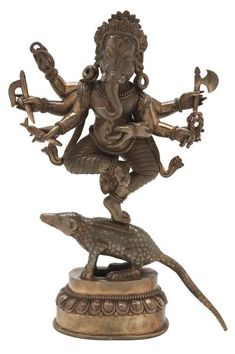 A multi-armed, dancing Ganesh balancing on a rat is considered to be extremely auspicious. Sri Ganesh, Lord Ganesha, Om Gam Ganapataye Namaha, Hindu Worship, Hindu Rituals, Sculptures, Lion Sculpture, Amazing India, India Culture
