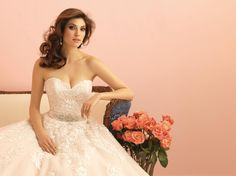 Breathtaking Allure Bridals wedding dress. Strapless ballgown with floral lace and beading belt around the waistline.
