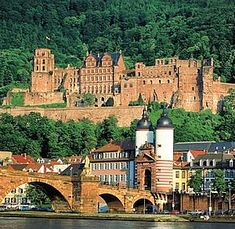 Heidelberg, Germany. Schön, ja? The Karl-Theodor-Bridge is pictured, with the Heidelberg Castle directly above that.