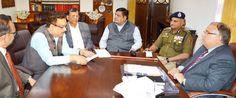 Chief Secretary B R Sharma chairing a meeting at Jammu.
