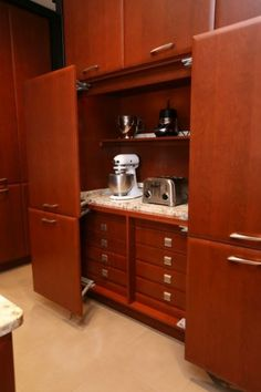 Turn a large cabinet into a baking station!  As long as there's an outlet nearby, this is a great use of space!
