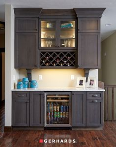 Dynesty/Omega cabinets with wine rack and small lighted cabinet accents. GerhardsStore.OmegaCabinetry.com
