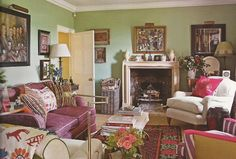 soft green sitting room & library with pink accents at William Yeoward's country home in England