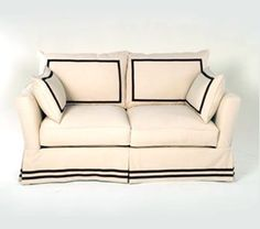 b/w double trim on bottom, slip cover our boring ikea sofa.  this would be good for a playroom.