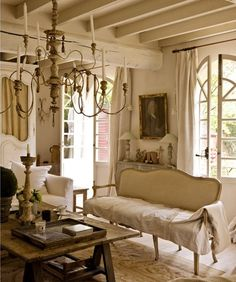 Patina. All painted a creamy color including rustic beams. Love it when floor joices can make for interesting ceiling. Arched french doors with interesting mullions. So many elements to love.