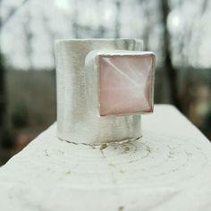 Brushed Sterling Silver Rose Quartz Pyramid Ring Stunning statement ring, hand forged wide band with slight flare using high quality sterling silver, pyramid rose quartz cabochon set in sterling silver, soldered to wide band, brushed finish. Ring size is 11. Please have your finger measured for correct fit.  Handcrafted with love by me. NWOT. ***CUSTOM ORDERS ARE ALWAYS WELCOMED *** CroweArt Jewelry Rings