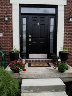 concrete-front-door-steps Black front doors are very versatile and suit any type of home Front Door Steps, Front Door Entrance, Exterior Front Doors, House Front Door, Glass Front Door, House Doors, House Entrance, Front Entrances, Front Door Decor