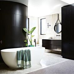 The most insanely sexy ensuite ever! As seen in @insideoutmag via @pondboutiques . Design by @tinalindnerbuildingdesign photo by @amellehabib. Styling by @greenhouseinteriors. #interior #interiordecor #interiorstyling #interiordesign #renovation #bathroom #blackandwhite #bath #soak #relax #amazing #inspire #thestylephiles by thestylephiles