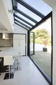 Love open to outside. Glass roof and walls with glazing bars running through in line. Huddersfield Kitchen Extension by Architecture in Glass by AproposUK, House Extension Design, Glass Extension, Rear Extension, Extension Ideas, Bifold Doors Extension, Side Return Extension, Kitchen Diner Extension, Kitchen Garden Extension, Orangery Extension Kitchen
