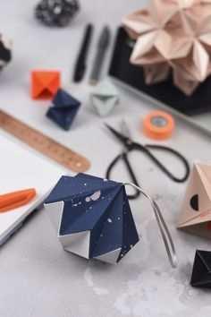 Origami-est makes adorable spinners and she has been using some of our wrap!  Some of the best product shots I've ever seen.