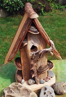 This style of house has bracket fungus, roots, stones and other items attached to a cedar/driftwood base. Driftwood Furniture, Driftwood Art, Driftwood Sculpture, Birdhouse Designs, Birdhouse Ideas, Bird House Kits, Decorative Bird Houses, Bird Aviary, Kit Homes