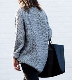 A simple gray sweater, jeans, and a black tote.