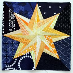 Rolling Star by Quilting on the Square paper pieced star quilt block found on Wombat quilts