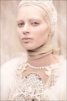 Photography by Tina Patni for Amato Haute Couture, good look for ice queen or a ghost...