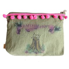 "Faith and Hope Cosmetic Bag by All Souls Mercantile. A tree stump sprouts new growth as two larks hold a banner saying ""faith and hope"" overhead. Pink pom poms. Hand crafted from recycled military surplus. Individually hand airbrushed. 9"" x 6 1/2"". $35"