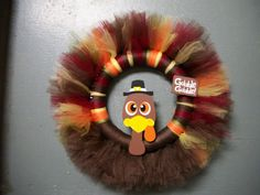This turkeys head with felt feathers from babies rabies wreath..