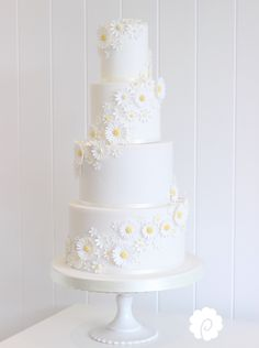 Fresh delicate white cascading daisies wedding cake