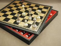 Staunton Metal Chessmen  With Storage Chest, $569, for the chess player in your life. #chesssetswithstorageboards