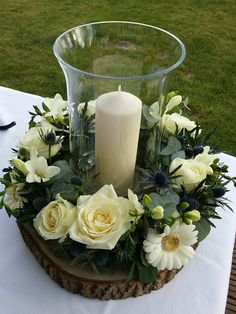 Wood slice centrepiece used as a display for flowers