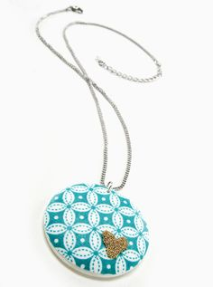 Fabric covered pendant with gold microbead heart accent. #necklace #MarthaStewart