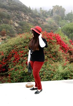 Inbetweenie winter style. A dressing your truth type 4 outfit. How to style a red felt hat and red cords. Burgundy corduroy pants, black top, black accessories. Plus size winter wear.
