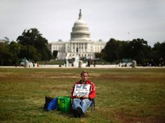 Furloughed Americorps employee Jeffrey Wismer holds a protest of one on the Washington Mall. The American government remains shutdown due to a budget dispute between Republicans and Democrats. (Jason Reed/Reuters)