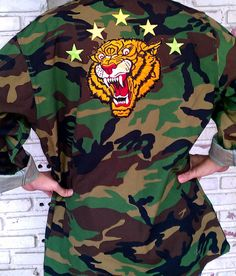 Check out this item in my Etsy shop https://www.etsy.com/listing/151522163/tiger-camo-jacket-reworked-vintage