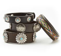 These unique bracelets are handmade from repurposed vintage tack leather and adorned with nickel silver, turquoise beads, and colorful hitched webbing.  MATERIAL: Leather; 8 inches long  COLOR: Dark brown  VARIATIONS: Buffalo Nickel Leather Cuff – four Conchos; Wind River Leather Cuff – multicolored braid; Turquoise Southwest Leather Cuff – five small Conchos with turquoise center; Southwest Turquoise Conchos Leather Cuff – four large Conchos with turquoise center.