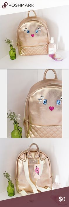 """NWT LUV BETSEY ROSE GOLD CAT BACKPACK Brand new with tag. Luv Betsey Johnson Rose Gold Jeweled Cat Face Backpack Shoulder Bag Dimension: 12"""" H x11.5""""W x 5""""D Inside: Wide open space, one zipped pocket and multipurpose open pockets. Gold metal details with logo Zip around closure. Luv Betsey Bags Backpacks"""