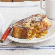 Thick slices of challah bread are stuffed with sautéed apples in this decadent French toast recipe.R... - Miki Duisterhof