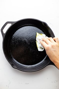 A hand using a paper towel to wipe oil in a black cast iron pan. Best Pizza Dough, Good Pizza, Cast Iron Skillet Pizza, Homemade Dough Recipe, Pizza Shapes, Making Homemade Pizza, Cast Iron Dutch Oven, Best Cheese, Iron Pan
