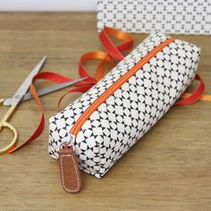 Caroline Gardner Geometric Print Pencil Case. I'd use this as a make up bag.