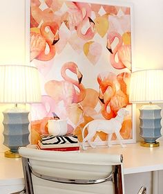 A flamingo painting. White office furniture