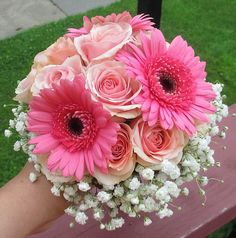 Light pink roses and dark pink chrysantemums combination in pink bridal bouqet
