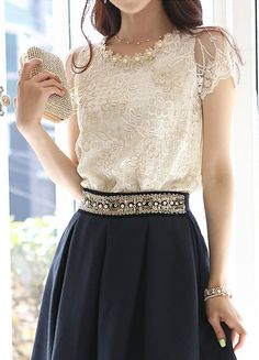. Ivory lace top and navy blue skirt with embellished waist.