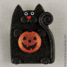 Big Glittery Black Happy Kitty Cat & Glittery Pumpkin Halloween Pin - SWris in Collectibles, Animals, Cats   eBay. Milo Happytail won a prize for being the fastest eater at the county fair! He won a great big marshmallow pumpkin...which he ate before he left the prize stand. He also ate third and fourth prizebeforeanybody could stop him.