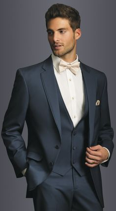 New style: the Slate Blue Allure Slim Fit Suit. It is gorgeous and works for outdoor weddings and ballrooms alike! Navy blue three piece wedding suit with bow tie.