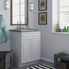 Help complete your bathroom decor with this inviting bath vanity cabinet, featuring two doors to store towels, toiletries and more. Crafted with a white stipple finish, this 24-inch vanity will add a fresh look to any bathroom.