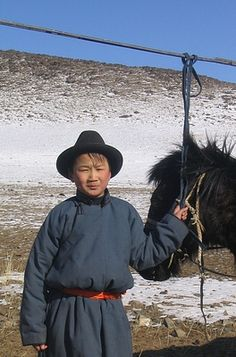 Mongolian boy withy his horse