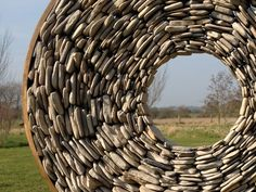 Tom Stogdon Sculpture.  Stogdon's website and portfolio are full of mind-boggling images of stone and metal work.