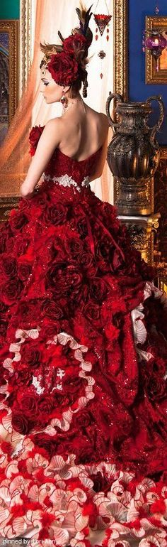 Stella de Libero: really red dress full of lace, swirls and rose flowers. Silky and stunning! Couture gown.