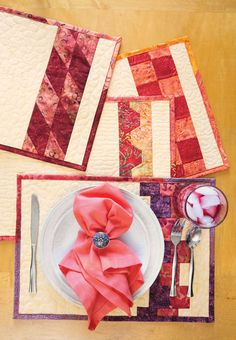 "Are you wondering what to do with leftover 2½""-wide strips? Each of these quick placemats uses just three. Choose a background fabric to complement your table. Learn how to make the Table for Four placemats in our free video tutorial."