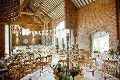 Located right on the edge of the Cotswolds, Swallows Nest Barn combines traditional barn character with modern and chic styling. Their idyllic 19th century barn gives the charming vibe that you want from a farm wedding venue whilst the glass shot room adds some serious style to the venue. As well as looking beautiful in the day time, Swallows Nest Barn transforms itself at night into an utterly romantic setting with dimmed lights and an outdoor courtyard perfect for evening drinks.