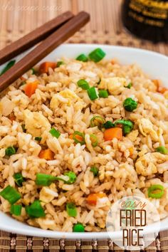 Easy Fried Rice. 2 cups cooked rice * 2 Tbs sesame oil 1 small white onion, chopped ½ frozen peas and carrots, thawed 2-3 Tablespoons soy sauce (more or less to taste) 2 eggs, lightly beaten 2 Tbsp chopped green onions (optional)
