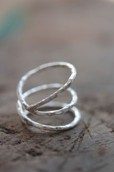 Open wrap silver ring with hammered texture by Storiesofsilversilk