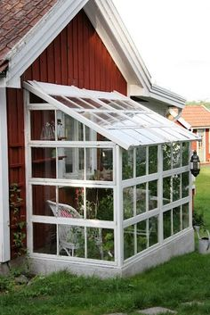 Beautiful and clever expansion. That seems like a nice, little project for the vacation week, right honey? (red wooden house with a plant filled little greenhouse/ sunroom) #greenhouse