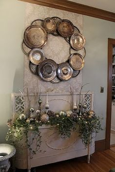wreath of old silver plates/platters  http://dishfunctionaldesigns.blogspot.com/2012/04/how-to-upcycle-thrift-shop-finds-into.html#